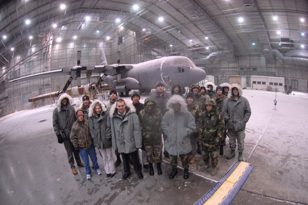 """EGLIN AIR FORCE BASE, Fla. -- A group of Airmen from the Eglin Junior Force Council visits the McKinley Climatic Laboratory during a tour of the lab during extreme cold testing on a C-130 Hercules. The group of EJFC members took advantage of an opportunity to explore the lab while the temperatures were at -40 degrees Fahrenheit, as part of a program """"Eglin Exploration."""" The program is a hands-on exploration of other missions on base designed for the junior force members. (U.S. Air Force photo by Staff Sgt. Mike Meares)"""