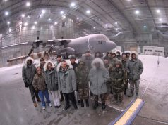 "EGLIN AIR FORCE BASE, Fla. -- A group of Airmen from the Eglin Junior Force Council visits the McKinley Climatic Laboratory during a tour of the lab during extreme cold testing on a C-130 Hercules. The group of EJFC members took advantage of an opportunity to explore the lab while the temperatures were at -40 degrees Fahrenheit, as part of a program ""Eglin Exploration."" The program is a hands-on exploration of other missions on base designed for the junior force members. (U.S. Air Force photo by Staff Sgt. Mike Meares)"