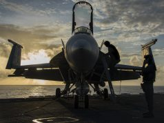 """(Feb. 07, 2017) Sailors assigned to the """"Kestrels"""" of Strike Fighter Squadron (VFA) 137, perform checks on an F/A-18E Super Hornet before flight operations on the aircraft carrier USS Carl Vinson (CVN 70) flight deck. The ship and its carrier strike group are on a regularly scheduled Western Pacific deployment as part of the U.S. Pacific Fleet-led initiative to extend the command and control functions of U.S. 3rd Fleet. U.S. Navy aircraft carrier strike groups have patrolled the Indo-Asia-Pacific regularly and routinely for more than 70 years. (U.S. Navy photo by Mass Communication Specialist 2nd Class Sean M. Castellano/Released)"""