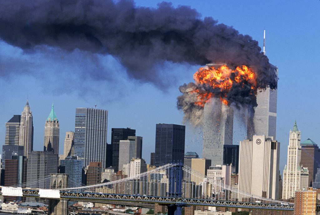 SEVENTH IN A PACKAGE OF NINE PHOTOS.–– An explosion rips through the South Tower of the World Trade Towers after the hijacked United Airlines Flight 175, which departed from Boston en route for Los Angeles, crashed into it Sept, 11, 2001. The North Tower is shown burning after American Airlines Flight 11 crashed into the tower at 8:45 a.m. (AP Photo/Aurora, Robert Clark)