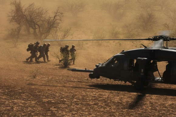 "An HH-60 Pave Hawk picks up pararescuemen and three ""survivors"" during Angel Thunder 2010 April 15, 2010, in the desert surrounding Davis-Monthan Air Force Base, Ariz., The pararescuemen are from the New York Air National Guard's 103rd Rescue Squadron in Long Island, N.Y.  (U.S. Air Force photo/Staff Sgt. Joshua L. DeMotts)"