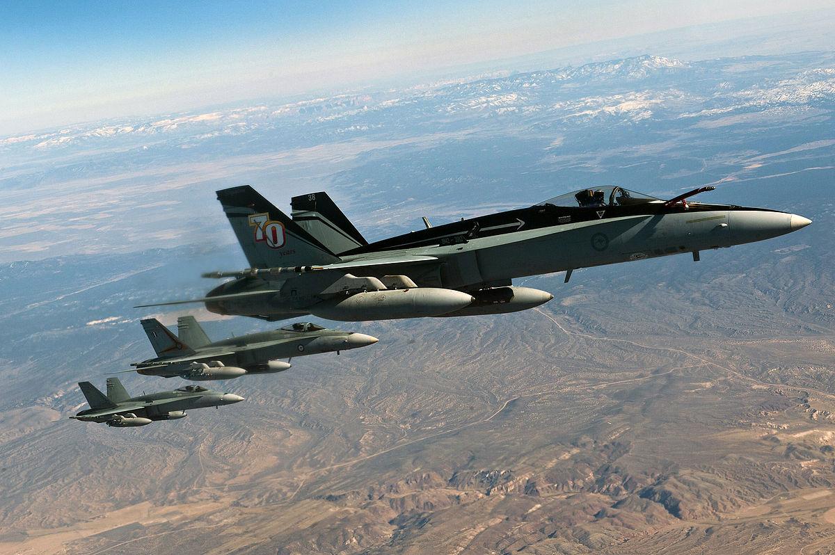 Three_RAAF_FA-18_Hornets_in_flight_at_Re